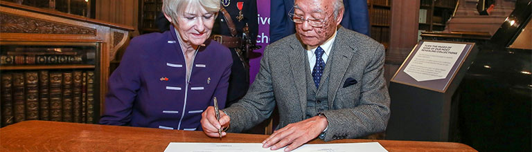 Dame Nancy Rothwell and Dr Lee Kai Hung in the John Rylands Library